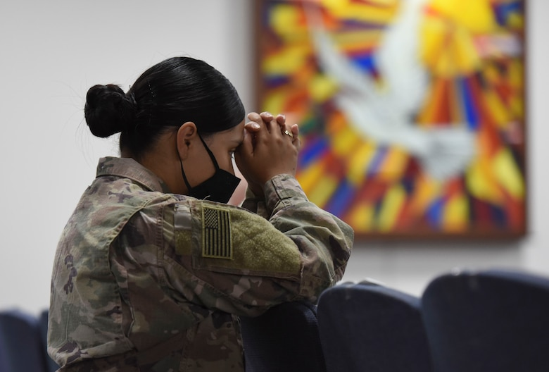 A U.S. Air Force Airman prays during a Catholic service at Ali Al Salem Air Base, Kuwait, Sept. 13, 2020.