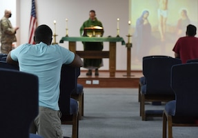 Chapel attendees pray during a Catholic service at Ali Al Salem Air Base, Kuwait, Oct. 26, 2020.