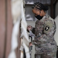 Sgt. Quayshaun Hopkins, a native of Hopkinsville, Ky., who is an automated logistical specialist assigned to 227th Composite Supply Company, 101st Division Sustainment Brigade, 101st Airborne Division (Air Assault), secures and package supplies on Camp Arifjan, Kuwait, October 23, 2020