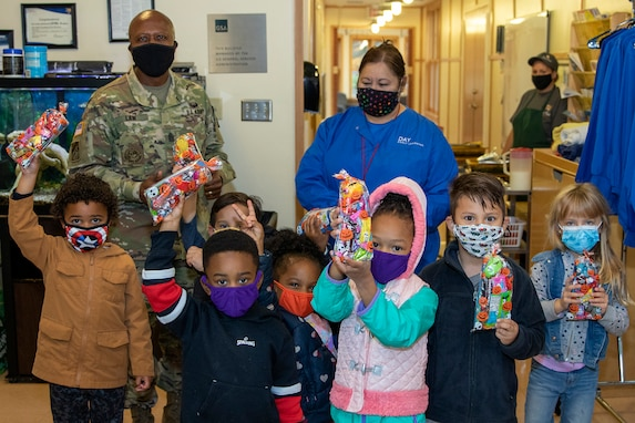 Command Sgt. Maj. Kenneth F. Law, U.S. Army Financial Management Command senior enlisted advisor, poses with several students at a childcare center located next to the Maj. Gen. Emmett J. Bean Federal Center Oct. 26, 2020. Law delivered more than 80 treat bags filled with candy and toys donated from USAFMCOM employees to give to the students, who typically parade through the Bean Center around Halloween each year. (U.S. Army photo by Mark R. W. Orders-Woempner)