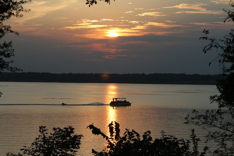 A boat pulls a tuber on a U.S Army Corps of Engineers lake.
