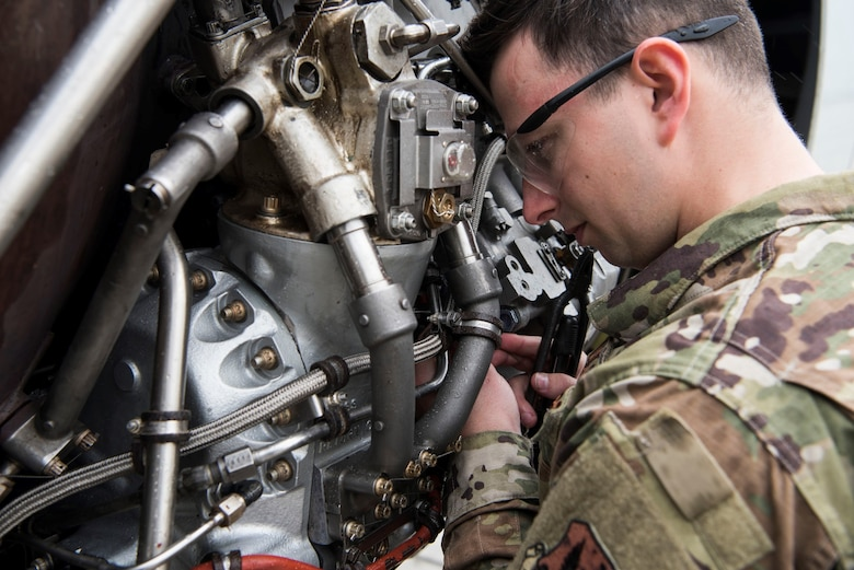 Photo of Airman working on an airplane.