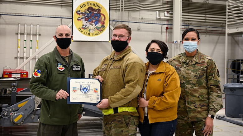 A photo of a STEP promotion to technical sergeant for Staff Sgt. Roger Delacy.
