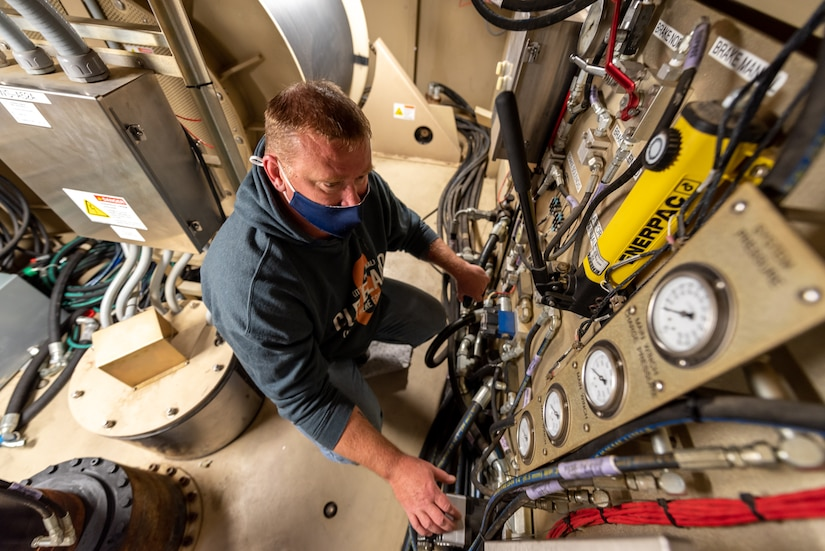 Photo of Electronics mechanic Jamie Shotto conducting a test inside the PSS-T trailer.