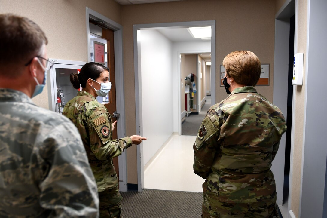 Airmen walk down a hall.