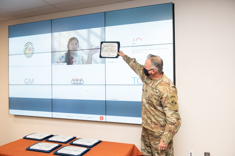 TAM Commander COL Philip Secrist presents a certificate to architect Angelivette Nieves-Viruet who completed the Leadership Development Program Tier I and graduated virtually from Puerto Rico.