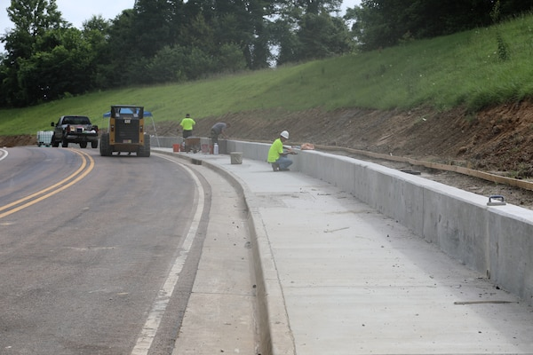 Contractors work build a new sidewalk near the Information Technology Laboratory at the U.S. Army Engineer Research and Development Center (ERDC) in Vicksburg, Miss. in September 2020. The work is part of the ERDC Master Plan, developed by the Installation Operations Division with a goal of enhancing quality of life and safety on all ERDC properties.