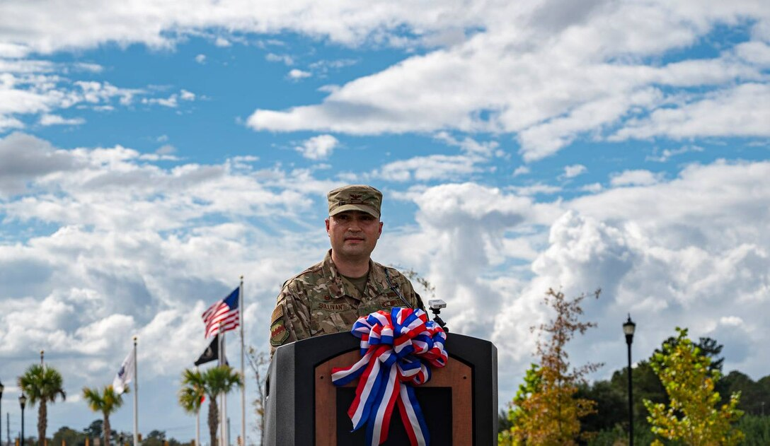 An Air Force member stands behind a podium.