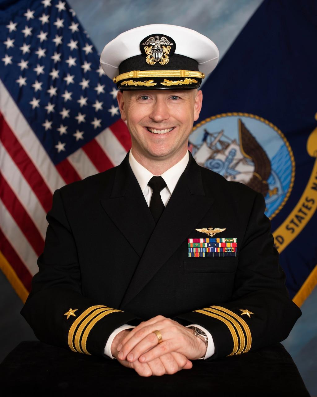 Official biography photo of Commander David Van Kampen, XO, VQ-1.
