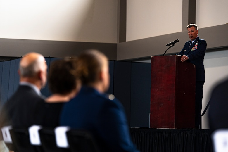 A photo of an Airman speaking during a ceremony