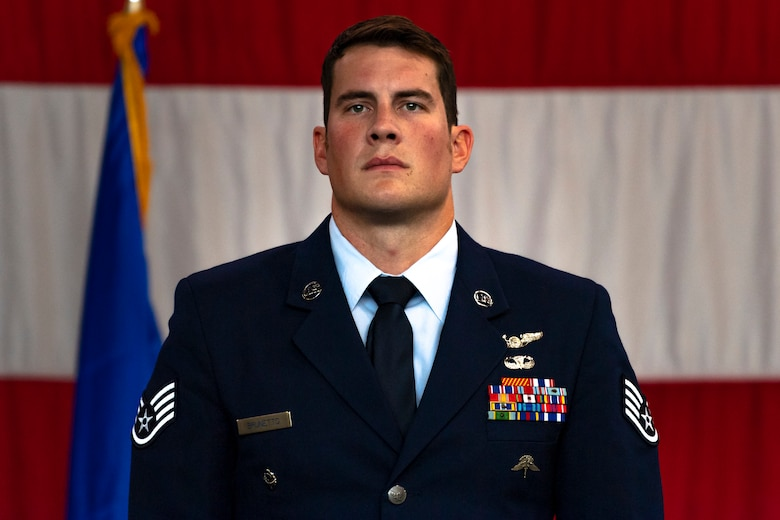 A photo of an Airman standing at attention during a ceremony