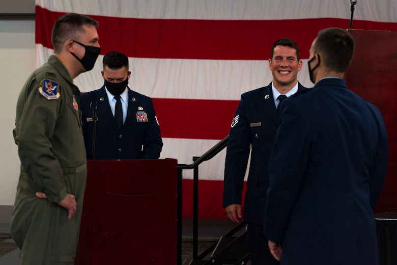 A photo of Airmen talking after a ceremony
