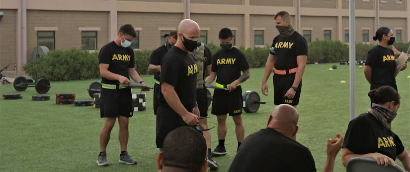 Staff Sgt. Eric Smith, G3 training noncommissioned officer, 1st Theater Sustainment Command, instructs Soldiers from the 311th Expeditionary Sustainment Command, 3rd Medical Command, 401st Army Field Support Brigade, and the 304th Sustainment Brigade on the grader requirements for the Army Combat Fitness Test at the Area Support Group-Kuwait Field Oct. 6, 2020 at Camp Arifjan, Kuwait. Smith and the 1st Theater Sustainment Command are responsible for ACFT familiarization and grader validation during the month of October ensuring readiness for the Army units currently serving at Camp Arifjan.  (U.S. Army Photograph by Spc. Andrew E. Figueroa)