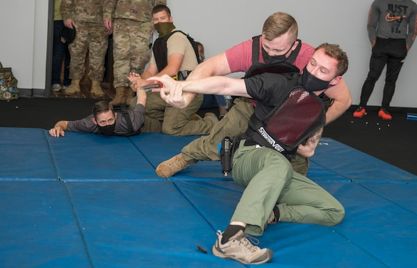 Staff Sgt. Kody Negri, 802d Security Forces Squadron, Staff Sgt. William McLaughlin, 502d SFS, Sgt. Michael Aulner, 502d SFS and Officer Jeremy Quinn, 802d SFS participate in combative training at the Alamo Area Council of Governments, San Antonio, Texas, Oct 22, 2020.