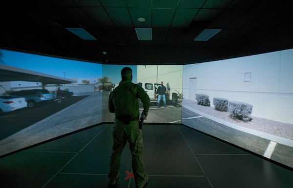 A member of the 502d Security Forces Squadron responds to a virtual hostile exercise at the Alamo Area Council of Governments, San Antonio, Texas, Oct 22, 2020.