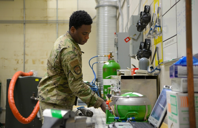 U.S. Air Force Airman 1st Class Xavier Smith, a 354th Maintenance Squadron Aircraft Electrical and Environmental Systems journeyman, works on a liquid oxygen on Eielson Air Force Base, Alaska, Oct. 7, 2020.