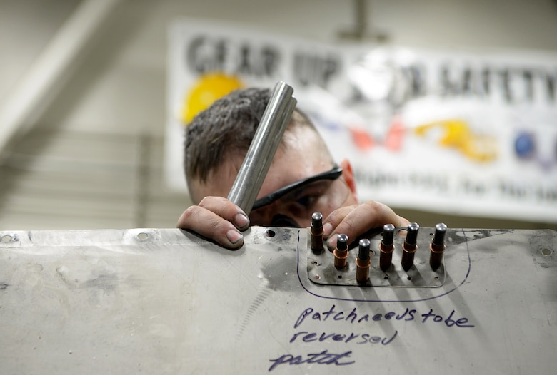 U.S. Air Force Airman 1st Class William Whitworth, a 354th Maintenance Squadron Aircraft Structural Maintenance journeyman, works on an F-16 Fighting Falcon panel on Eielson Air Force Base, Alaska, Oct. 8, 2020.