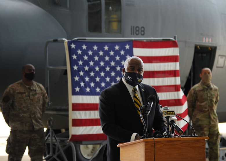 Dr. Quinton T. Ross Jr., president of Alabama State University, addresses the crowd at the nose art unveiling ceremony held at Maxwell Air Force Base, Alabama. The 908th Airlift Wing commemorated its partnership with ASU by painting the university's logo on the nose of one of its C-130 H aircraft. (U.S. Air Force photo by Senior Airman Max Goldberg)