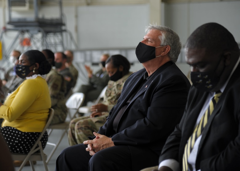 Members of the 908th Airlift Wing and representatives of Alabama State University attend the nose art unveiling ceremony at Maxwell Air Force Base, Alabama. The 908th AW commemorated its partnership with ASU by painting the university's logo on the nose of one of its C-130 H aircraft. (U.S. Air Force photo by Senior Airman Max Goldberg)