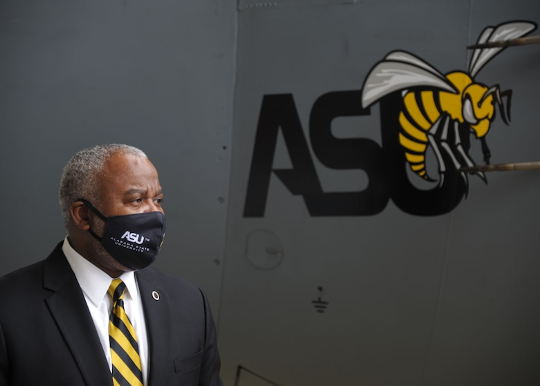 Dr. Quinton T. Ross Jr., president of Alabama State University, stands by the newly unveiled ASU nose art at Maxwell Air Force Base, Alabama. The 908th Airlift Wing commemorated its partnership with ASU by painting the university's logo on the nose of one of its C-130 H aircraft. (U.S. Air Force photo by Senior Airman Max Goldberg)