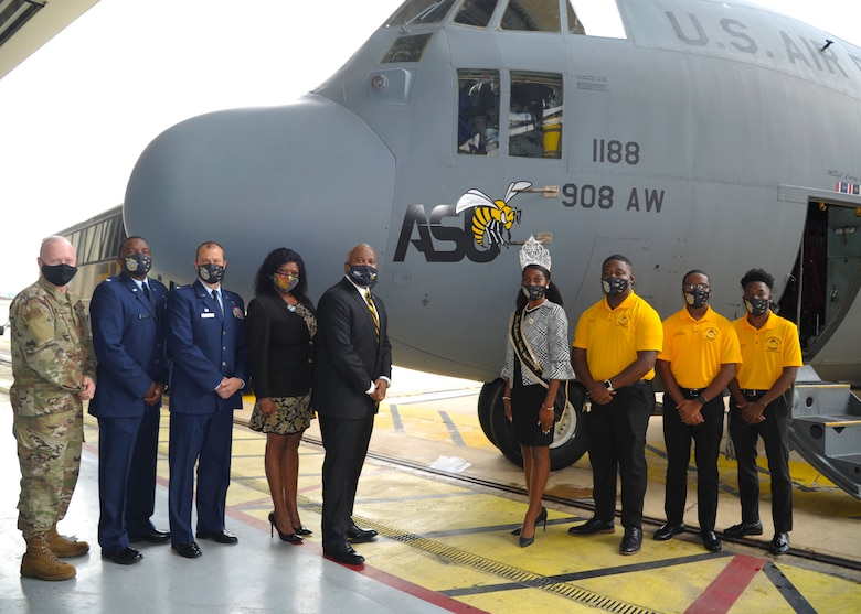 Members of the 908th Airlift Wing and representatives of Alabama State University pose for a photo in front of the newly unveiled ASU nose art at Maxwell Air Force Base, Alabama. The 908th AW commemorated its partnership with ASU by painting the university's logo on the nose of one of its C-130 H aircraft. (U.S. Air Force photo by Senior Airman Max Goldberg)