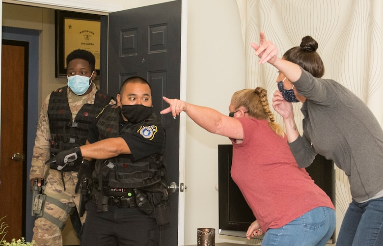 Officer Joseph Martinez, 802nd Security Forces Squadron, and Senior Airman Marcus Allen, 902nd SFS, respond during a domestic violence exercise at the Alamo Area Council of Governments, San Antonio, Texas, Oct 22, 2020. Security Forces were able to work with law enforcement training instructors from AACOG  to get a perspective outside the traditional security forces training.