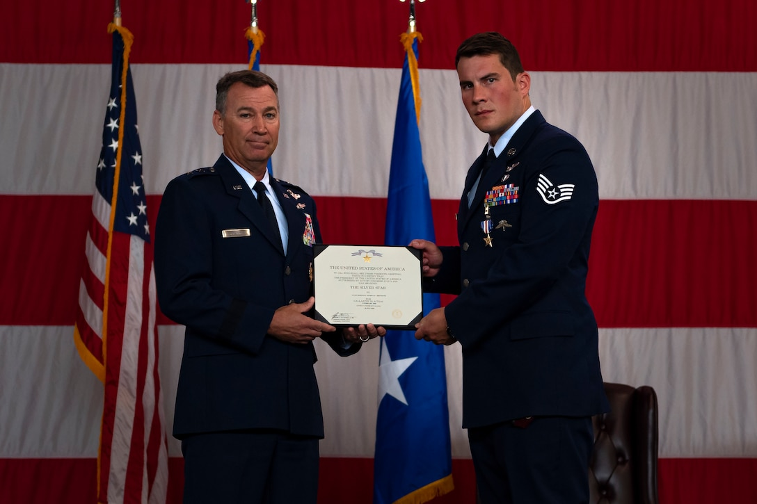 A photo of an Airman receiving a certificate