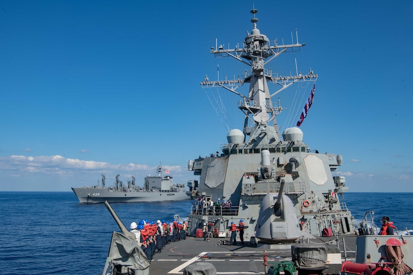 USS Barry (DDG 52) breaks away following an underway replenishment with the  Japan Maritime Self Defense Force (JMSDF) Mashu-class replenishment ship JS Mashu (AOE 425) during exercise Keen Sword 21.