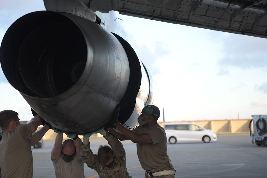 5th Expeditionary Airborne Command and Control Squadron Joint Surveillance Target Attack Radar System team members work together to remove outer engine components of an E-8C Joint STARS aircraft at Kadena Air Base, Japan, Sept. 24, 2020. The Air National Guard and active duty members from Robins Air Force Base, Georgia, are on three-month rotations to work with the 5th EACCS on KAB to promote total force integration and joint interoperability. (U.S. Air Force photo by Airman 1st Class Rebeckah Medeiros)