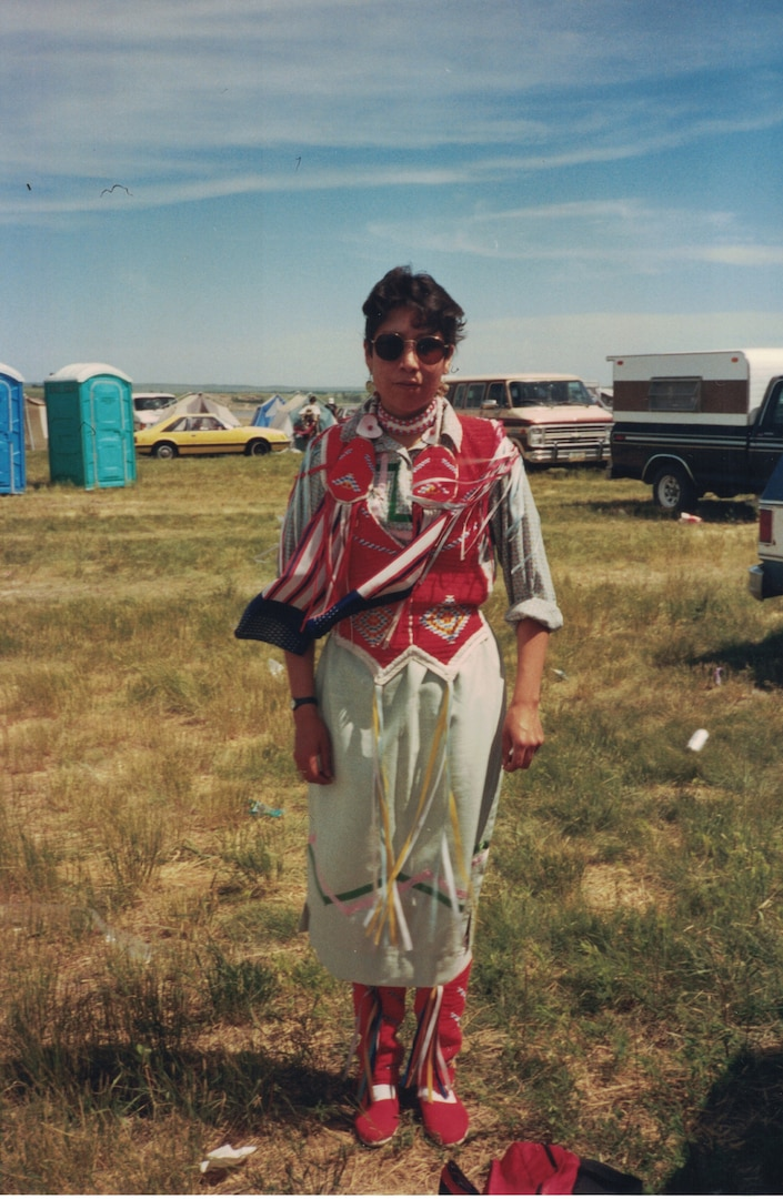 Air Force Master Sgt. Mary Lohnes Dressed in traditional Native American Regalia to attend a Wacipi in Cannon Ball, N.D. while on leave from the U.S. Army.