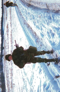Mary Lohnes, on patrol during a winter exercise while an Active Guard Reservist with Nebraska Army National Guard.