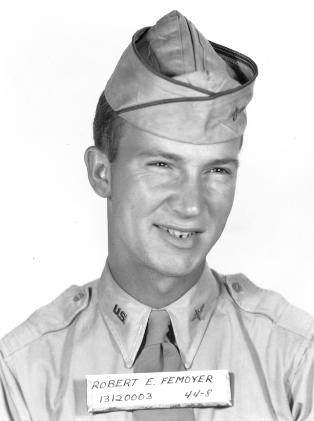 A man in uniform smiles for the camera.