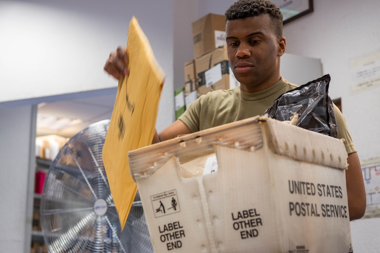 U.S. Air Force Airman 1st Class Michael Troutman, 786th Force Support Squadron military postal clerk, sorts mail at the Northside Post Office at Ramstein Air Base, Germany, Oct. 28, 2020. The post office uses a collection of bins and containers to sort and store mail for customers. (U.S. Air Force photo by Senior Airman Noah Coger)