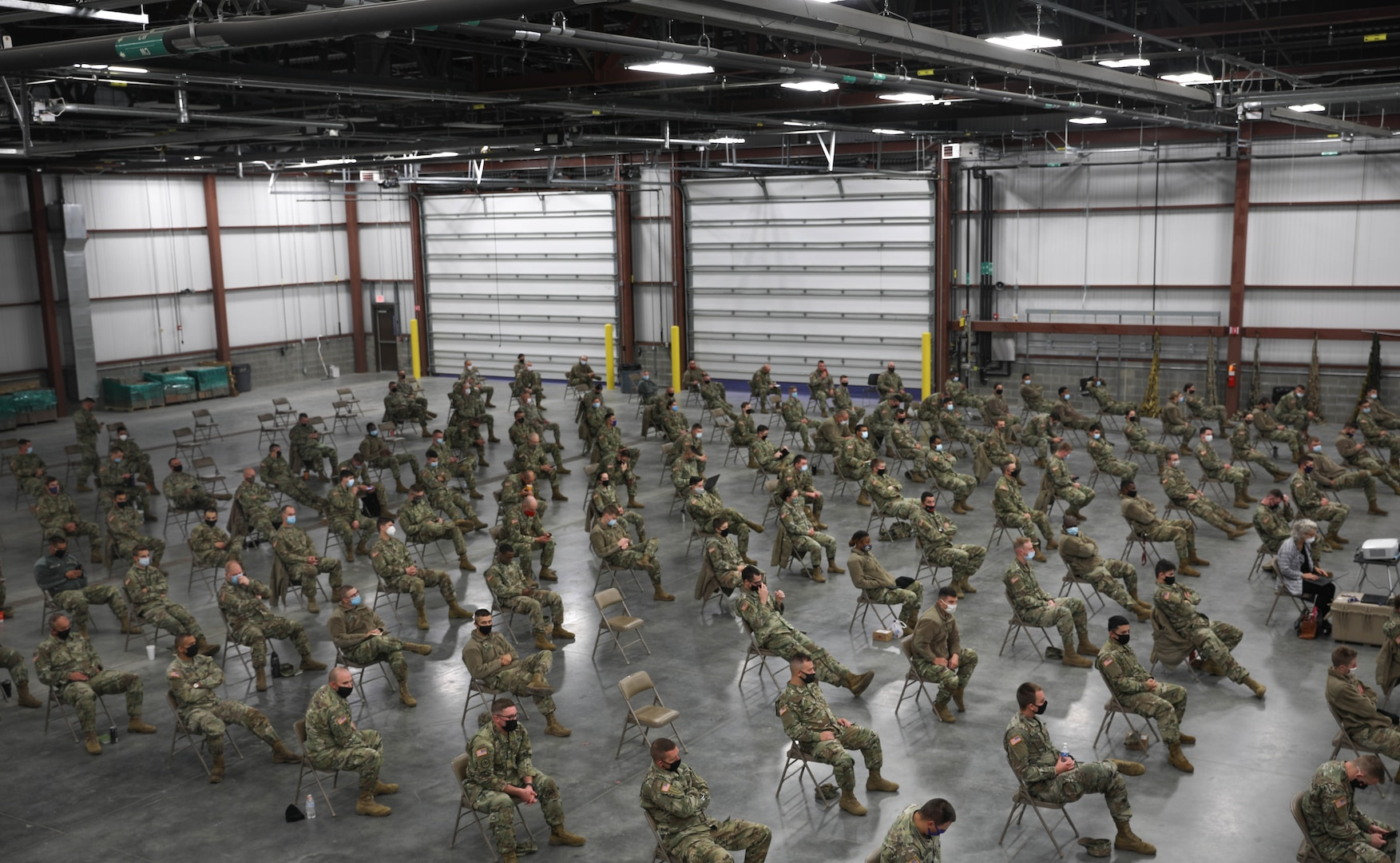 Indiana National Guard Soldiers listen to Brig. Gen. Dale Lyles, the adjutant general, Oct. 30, 2020, before their training mission supporting long-term care facilities throughout the state. More than 1,300 members of the Indiana National Guard will assist with testing and other measures to limit the spread of COVID-19 at the facilities.