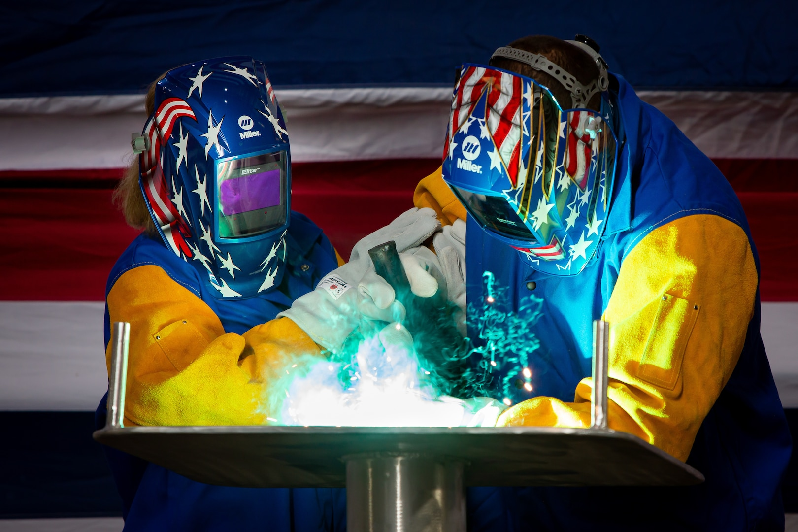 MOBILE, Ala. (Oct. 28, 2020) Lolita Zinke, left, the sponsor of the future littoral combat ship USS Santa Barbara (LCS 32), welds her initials into the ship's keel plate during a keel-laying ceremony at Austal USA in Mobile, Alabama, Oct. 27, 2020.
