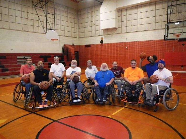 The RTI-Wheelin' Wildcats wheelchair basketball team poses for a group photo.