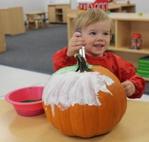 Tucker, 2, paints his pumpkin Oct. 23, 2020, at Schriever Air Force Base, Colorado. The 50th Force Support Squadron provided pumpkins to Team Schriever members as part of their planned activities for Halloween. (U.S. Space Force photo by Marcus Hill)