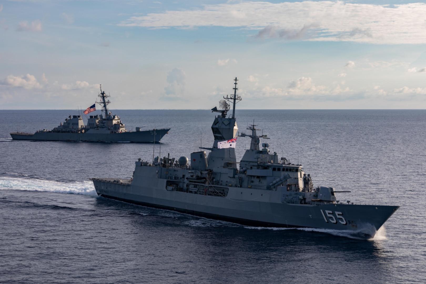 USS John S. McCain sails alongside HMAS Ballarat