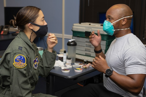 Staff Sgt. Cameron Chisolm, 47th Operations Support Squadron Aerospace & Physiology NCO in charge of administration and scheduling, applies moulage to Capt. Ally Bergman, 47th Operations Support Squadron Aerospace & Physiology Flight commander, on Oct. 27, 2020 at Laughlin Air Force Base, Texas. Bergman was one of numerous people from across base who wore a made-up bruise for the Black Eye Campaign to bring focus to Domestic Violence Awareness Month. (Courtesy Photo)