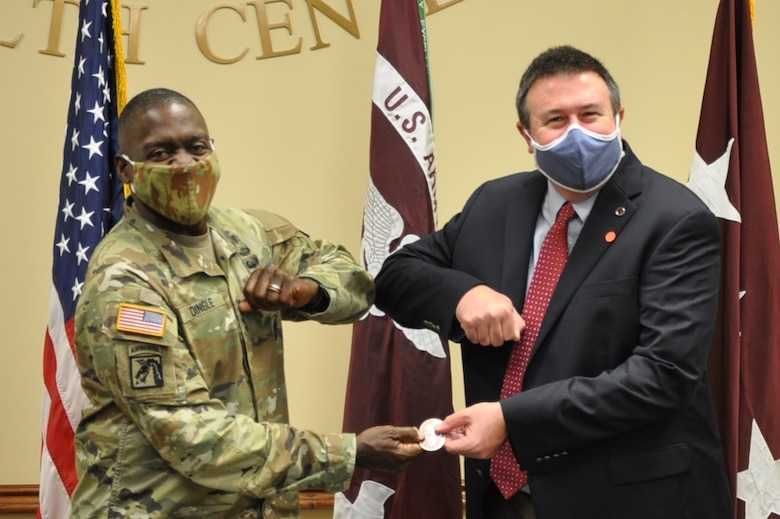 During a visit to Fox Army Health Center at Redstone Arsenal Tuesday, Lt. Gen. R. Scott Dingle, U.S. Army Surgeon General, took the time to recognize members of the U.S. Army Engineering and Support Center, Huntsville's Medical Division, including Wes Turner, Medical Division chief.