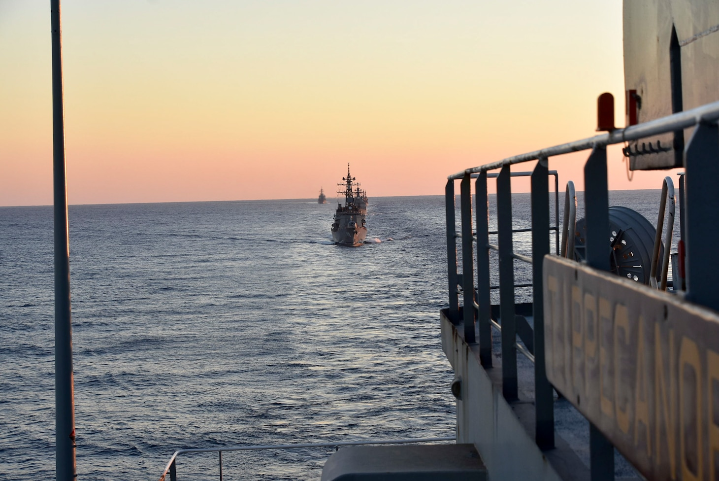 PHILIPPINE SEA (Oct. 25, 2020) – The Royal Canadian Navy Halifax-class frigate HMCS Winnipeg (FFH 338) approaches the U.S. Navy Military Sealift Command Henry J. Kaiser-class fleet replenishment oiler USNS Tippecanoe (T-AO 199) in preparation for an underway replenishment prior to participating in Keen Sword. Keen Sword is a joint, bilateral, biennial field-training exercise involving U.S. military and Japan Self-Defense Force personnel, designed to increase combat readiness and interoperability of the Japan-U.S. alliance. (US. Navy photo by Christopher Bosch)