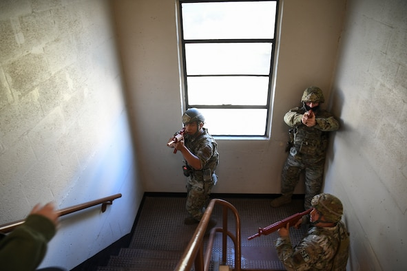 Security Forces Airmen search for active shooter.