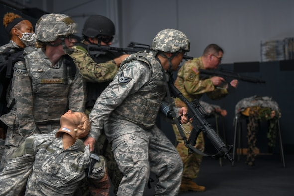 Soldiers, Sailors and Airmen participate in 'Care Under Fire' and Tactical Field Care as part of their Tactical Combat Casualty Care assessment.