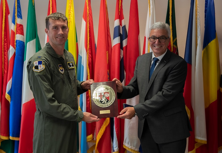 U.S. Air Force Col. David Epperson, 52nd Fighter Wing Commander, receives a plaque from Roger Lewentz, Minister of the Interior for the State of Rheinland-Pfalz, at Spangdahlem Air Base, Germany, Aug. 28, 2020. Lewentz gave the plaque to Epperson as appreciation of the friendship and partnership between the 52nd FW and Rheinland-Pfalz. (U.S. Air Force photo by Airman 1st Class Alison Stewart)