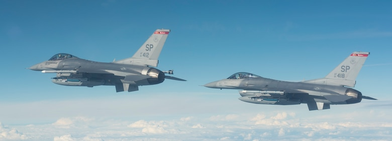 Two U.S. F-16 Fighting Falcons attached to the 480th Expeditionary Fighter Squadron, fly towards the D-37 Range in Nadarzyce, Poland, 24 August 2020. Through strengthened relationships and engagements with our Allies, the United States and NATO demonstrate their shared commitment to a peaceful, stable and secure Europe. (U.S. Air Force photo by Senior Airman Chanceler Nardone)