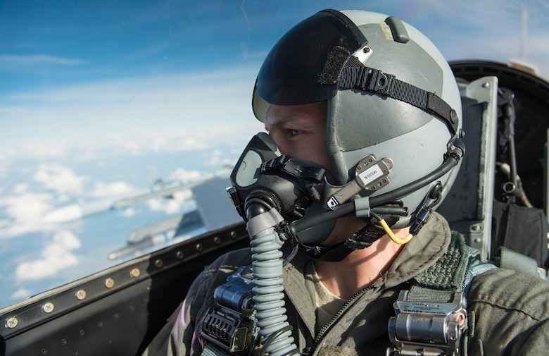 Senior Airman Chance Nardone, 52nd Fighter Wing Public Affairs, broadcast journalist, takes a selfie while documenting two F-16 Fighting Falcons, attached to the 480th Expeditionary Fighter Squadron, on their way to drop inert guided bombing units at the D-37 Range in Nadarzyce, Poland, 24 August 2020. The 480th's presence in Poland during Aviation Detachment Rotation 20-4 has allowed for increased joint readiness and strengthened relationships between the two NATO Allies. (U.S. Air Force photo by Senior Airman Chanceler Nardone)