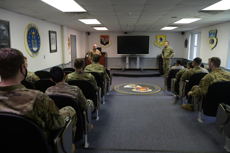 Chief Master Sgt. Jason Colón, left, 628 Air Base Wing Command Chief and Col. Marc Greene, 628th ABW commander, speak to Airmen of Class 20-E of Airman Leadership School at Joint Base Charleston, S.C., Aug. 26, 2020. Colón rose through the ranks as a Special Operations Weather Technician and has been in the Air Force for 30 years.