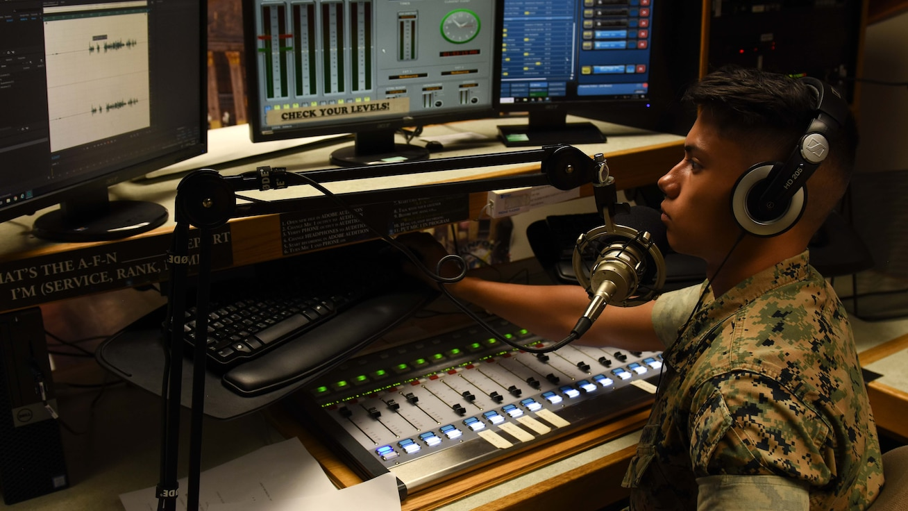 A DINFOS student trains in the school's radio studio.