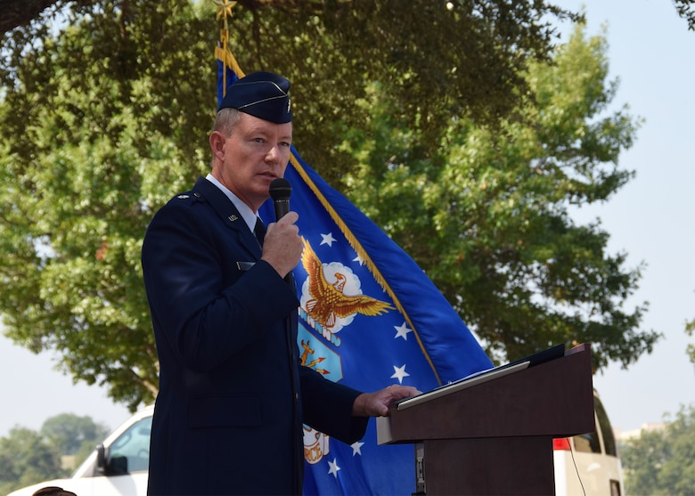 Lt. Col. Douglas P. Schoenenberger, 68th Airlift Squadron commander and ceremony narrator, speaks during the remembrance and wreath laying ceremony for the 30th anniversary of the BRAVO-12 mission held Aug. 28, 2020 at Joint Base San Antonio-Lackland, Texas.