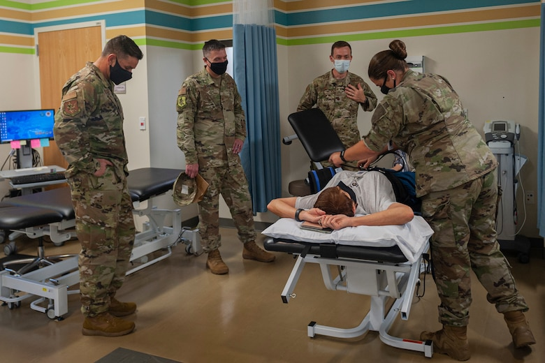 Photo of an Airman demonstrating a lumbar traction technique